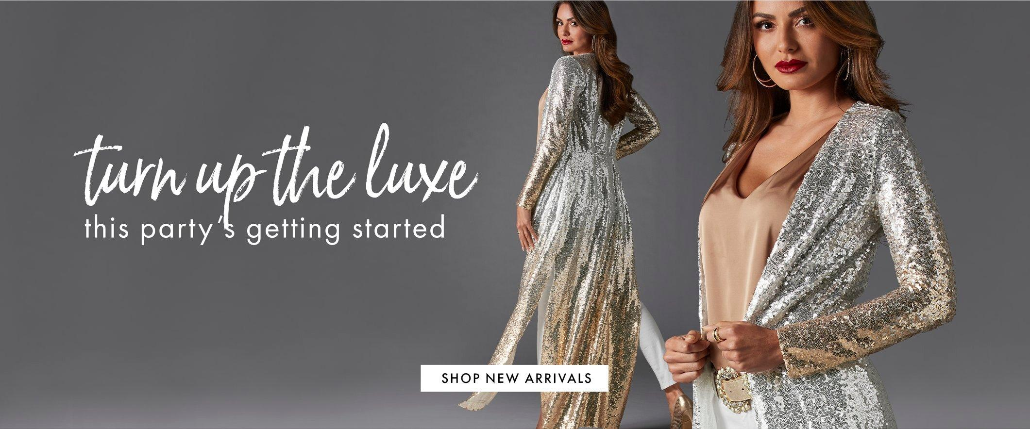 model wearing a silver and gold ombre sequin duster, tan v-neck top, gold jeweled belt, and white jeans. text: turn up the luxe. this party's getting started.