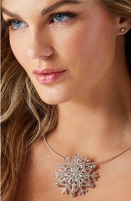 model wearing a silver rhinestone snowflake necklace.