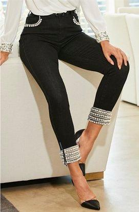 model wearing black pearl embellished jeans.