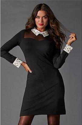 model wearing a black long-sleeve dress with a white jeweled collar and cuffs.