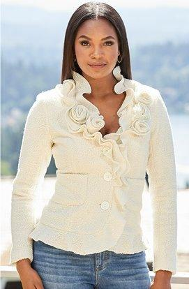 model wearing an off-white rosette cardigan.