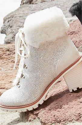 white sparkle faux-fur cuff lace-up booties.