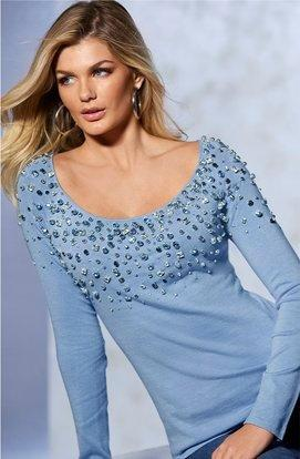 model wearing a blue jeweled scoop neck sweater.