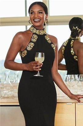 model wearing a black and gold embellished high-neck sleeveless maxi dress.