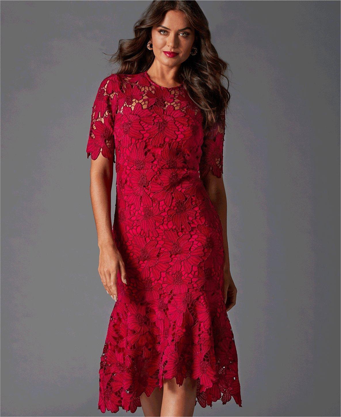 model wearing a red lace short sleeve sheath dress.