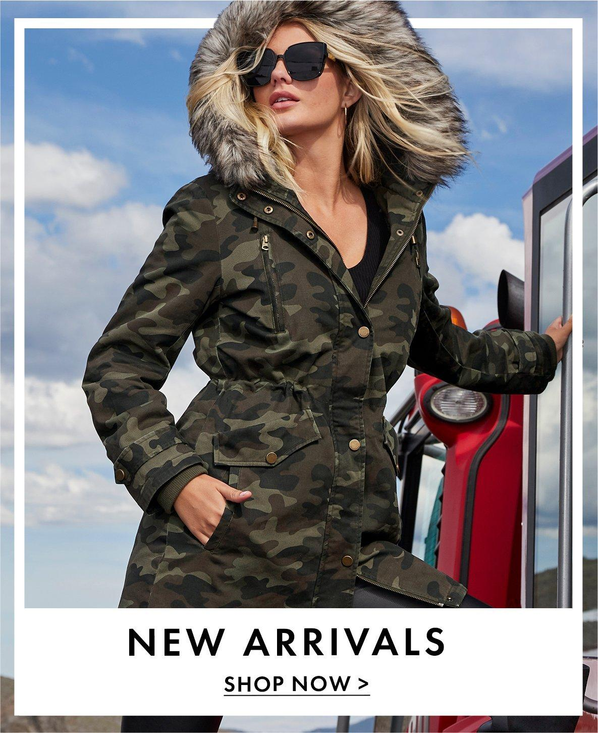 model wearing a camouflage faux fur coat and sunglasses. text: new arrivals. shop now.