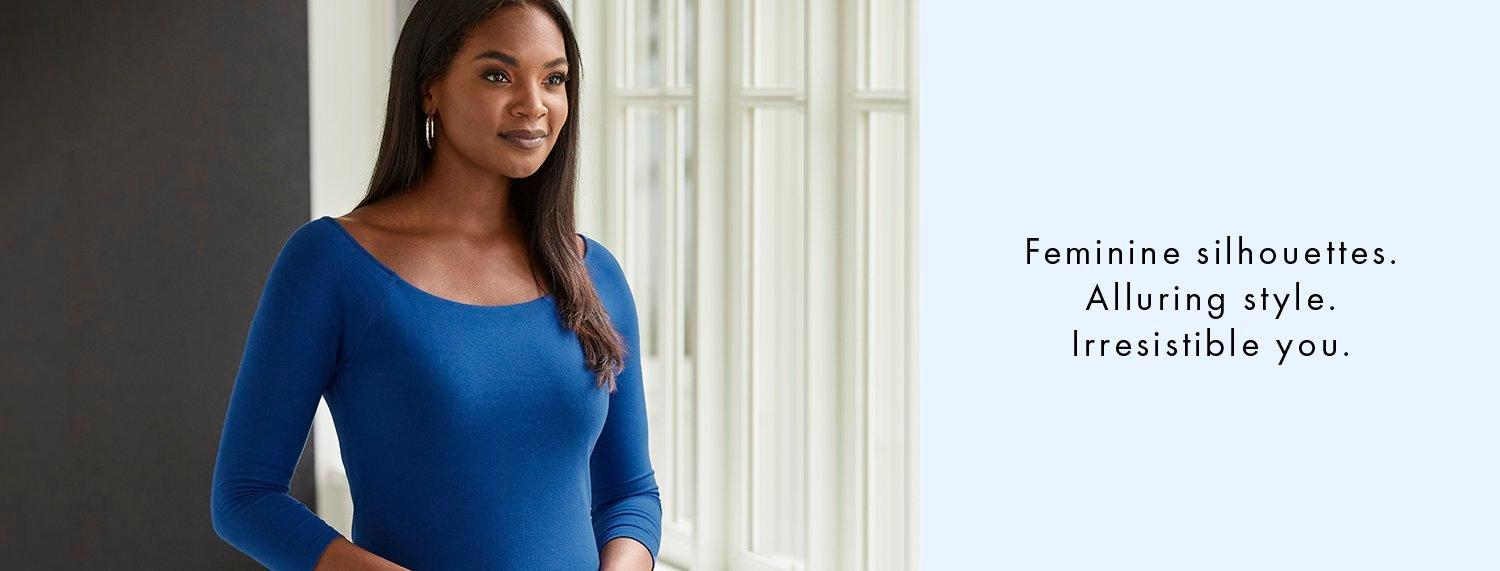 model wearing a blue scoop neck three-quarter sleeve top. right text: feminine silhouettes. alluring style. irresistible you.