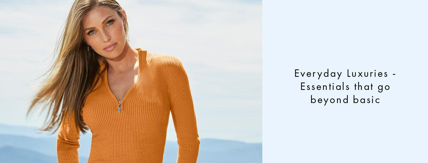 model wearing a golden yellow ribbed quarter zip sweater.