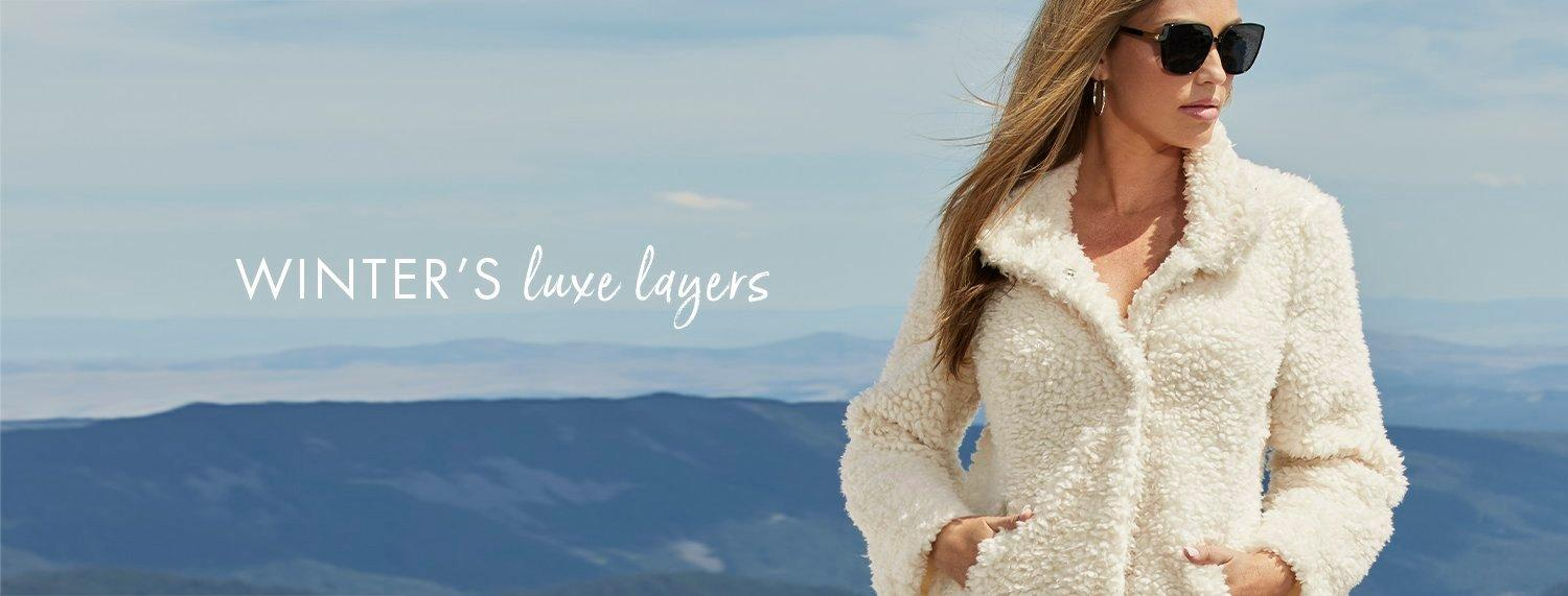 model wearing a plush off-white teddy coat and sunglasses. text: winter's luxe layers.