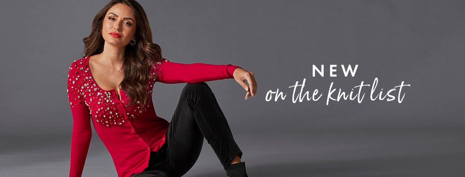 model wearing a red jewel embellished button down cardigan and black velvet pants. text: new on the knit list.