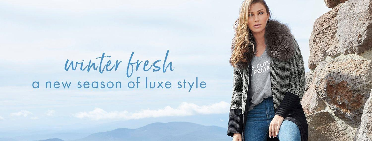 model wearing a gray and black color-block faux-fur sweater coat, gray v-neck tee, and jeans. text: winter fresh. a new season of luxe style.
