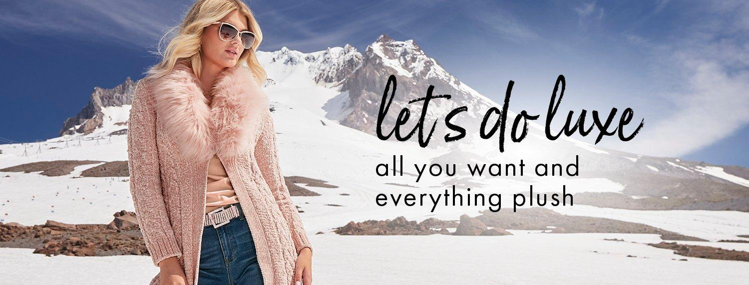 model wearing a pink faux-fur sweater duster, pale pink top, rose gold rhinestone belt, jeans, and sunglasses. text: let's do luxe. all you want and everything plus.