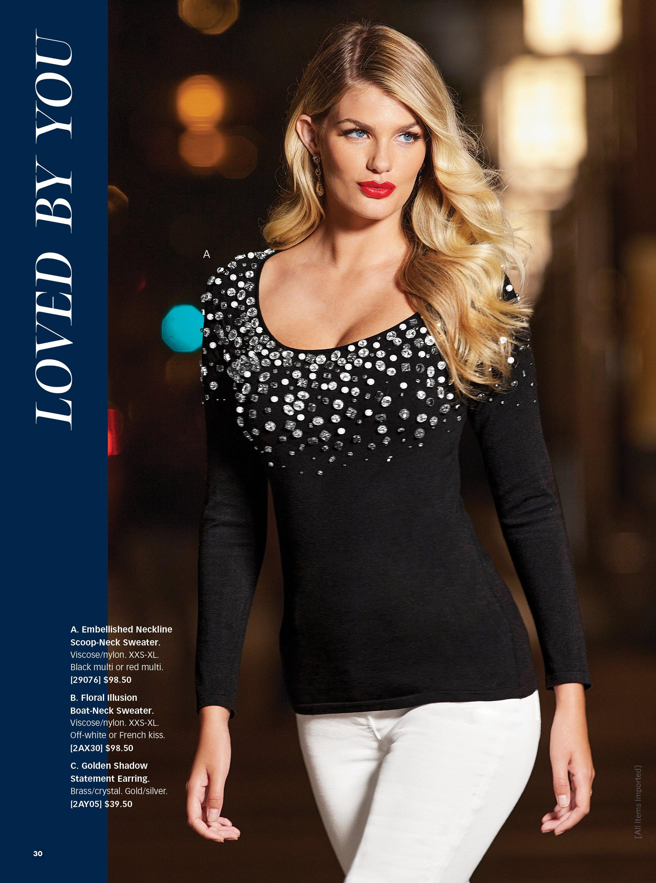model wearing a black jewel embellished scoop-neck sweater and white pants.