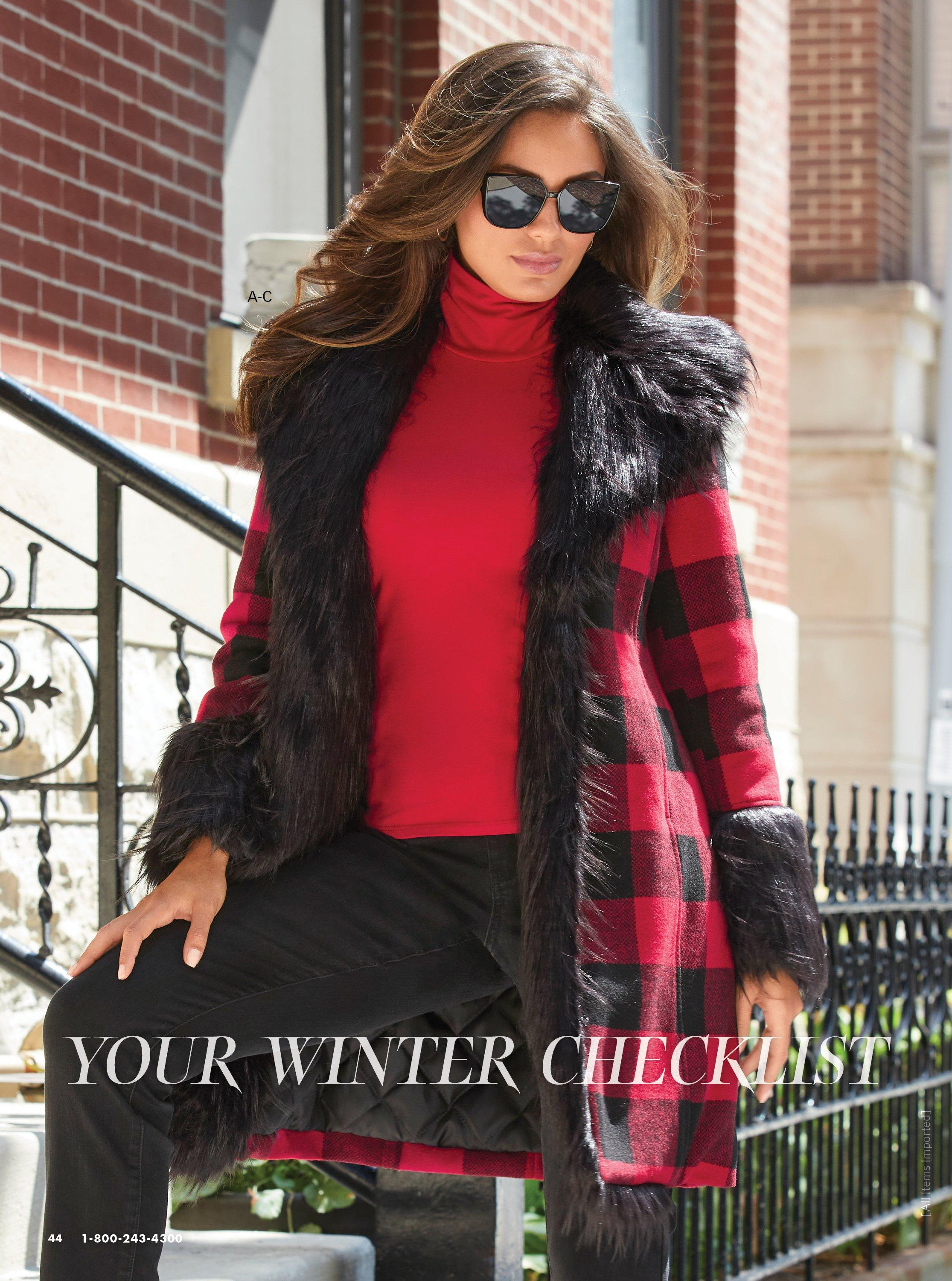 model wearing a red and black faux fur lined plaid jacket, red turtleneck top, and jeans.