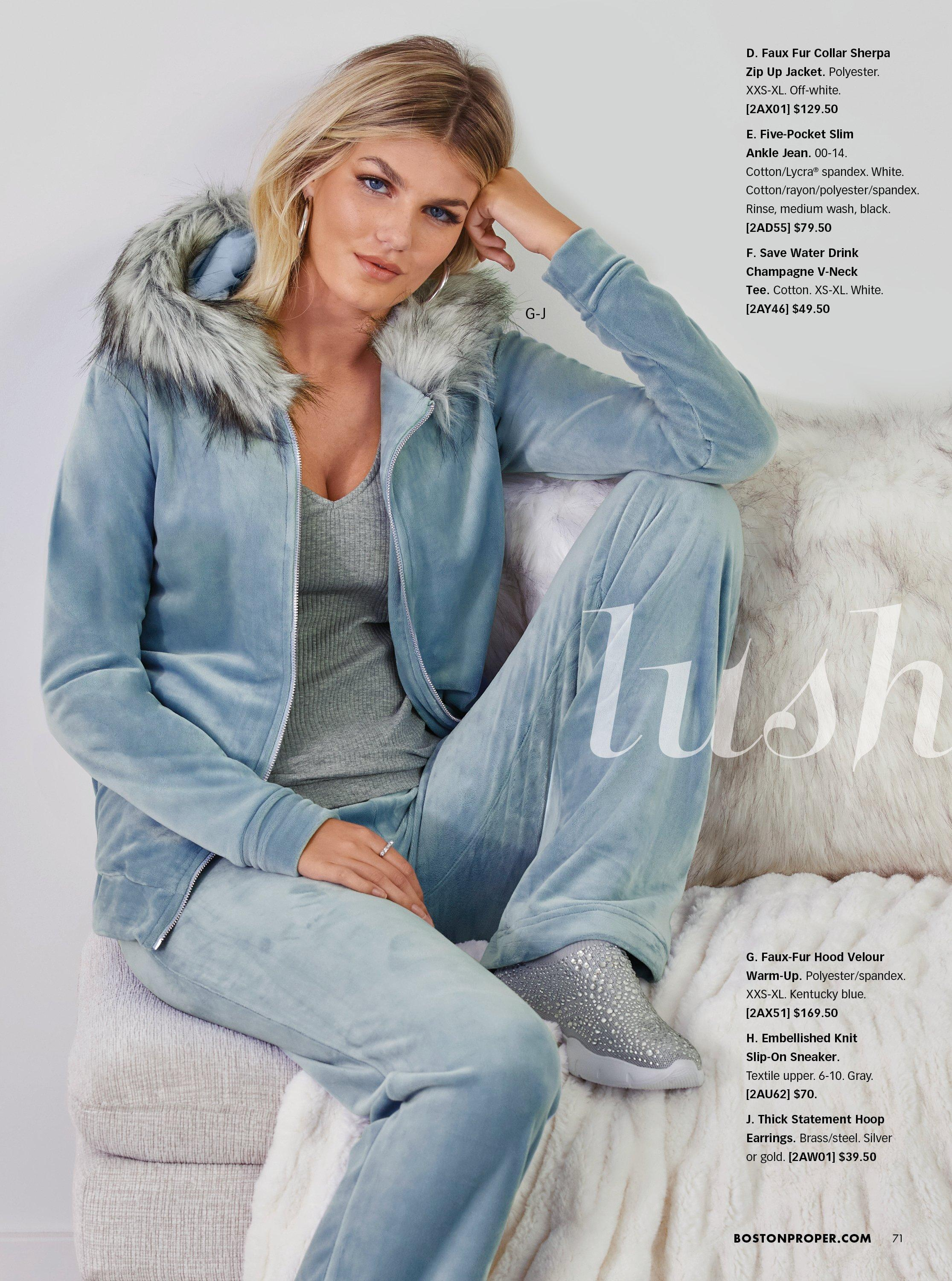 model wearing a light blue velour faux fur two-piece lounge set, gray tank top, and gray rhinestone embellished slip on sneakers.