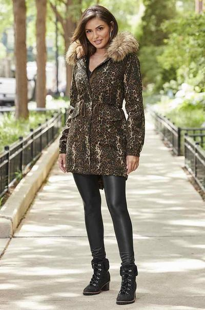 model wearing a leopard print faux fur coat, black faux leather leggings, and black faux-fur heeled booties.