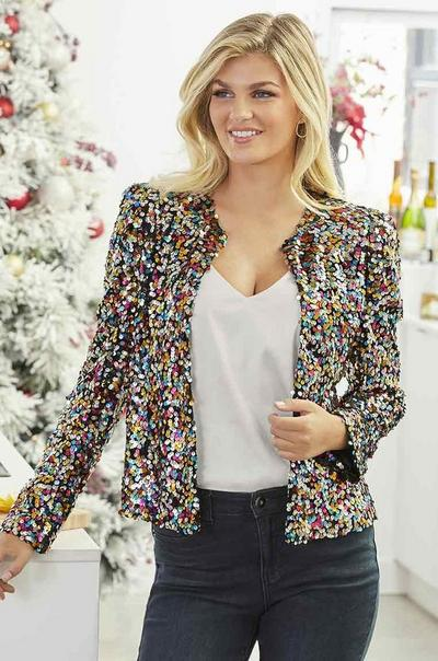 model wearing a multicolored sequin blazer, white v-neck tank top, and jeans.