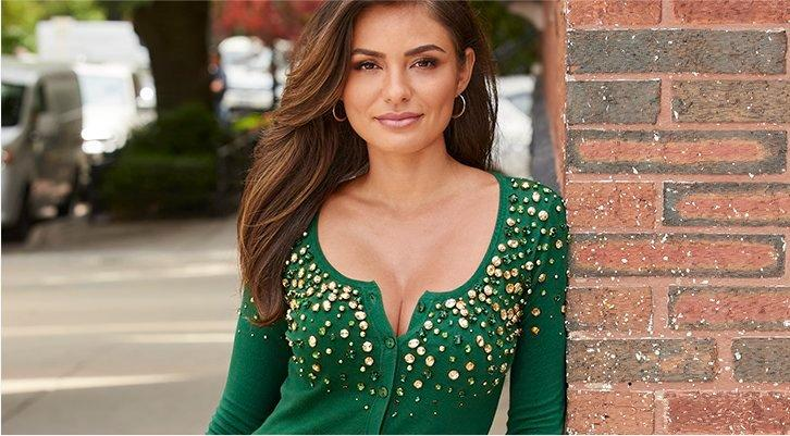model wearing a green jewel embellished button-up cardigan.