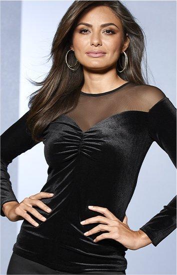model wearing a black illusion velvet long-sleeve sweetheart top.