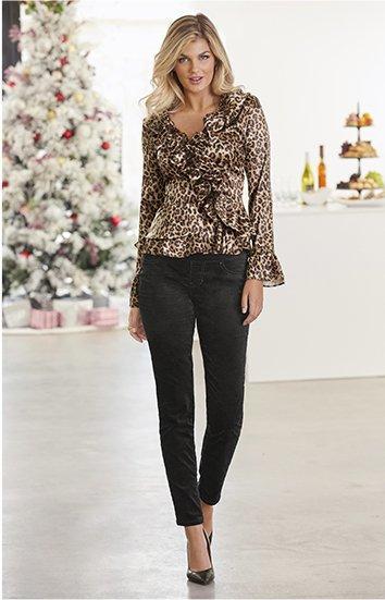 model wearing a leopard print ruffle long-sleeve top, black velvet pants, and black pumps.