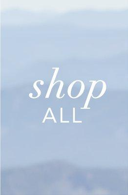 white text on blue gradient background: shop all.