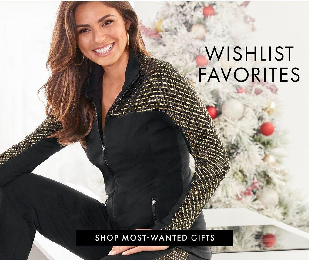 model wearing a black and gold two-piece warm-up set. text: wishlist favorites. shop most-wanted gifts.