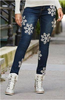 model wearing a black and silver printed jeans.