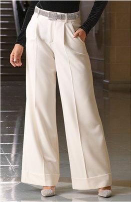 model wearing white high-waisted wide-leg pants and silver rhinestone belt.