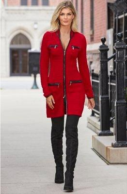 model wearing a red and black sweater coat, black leggings, and black booties.
