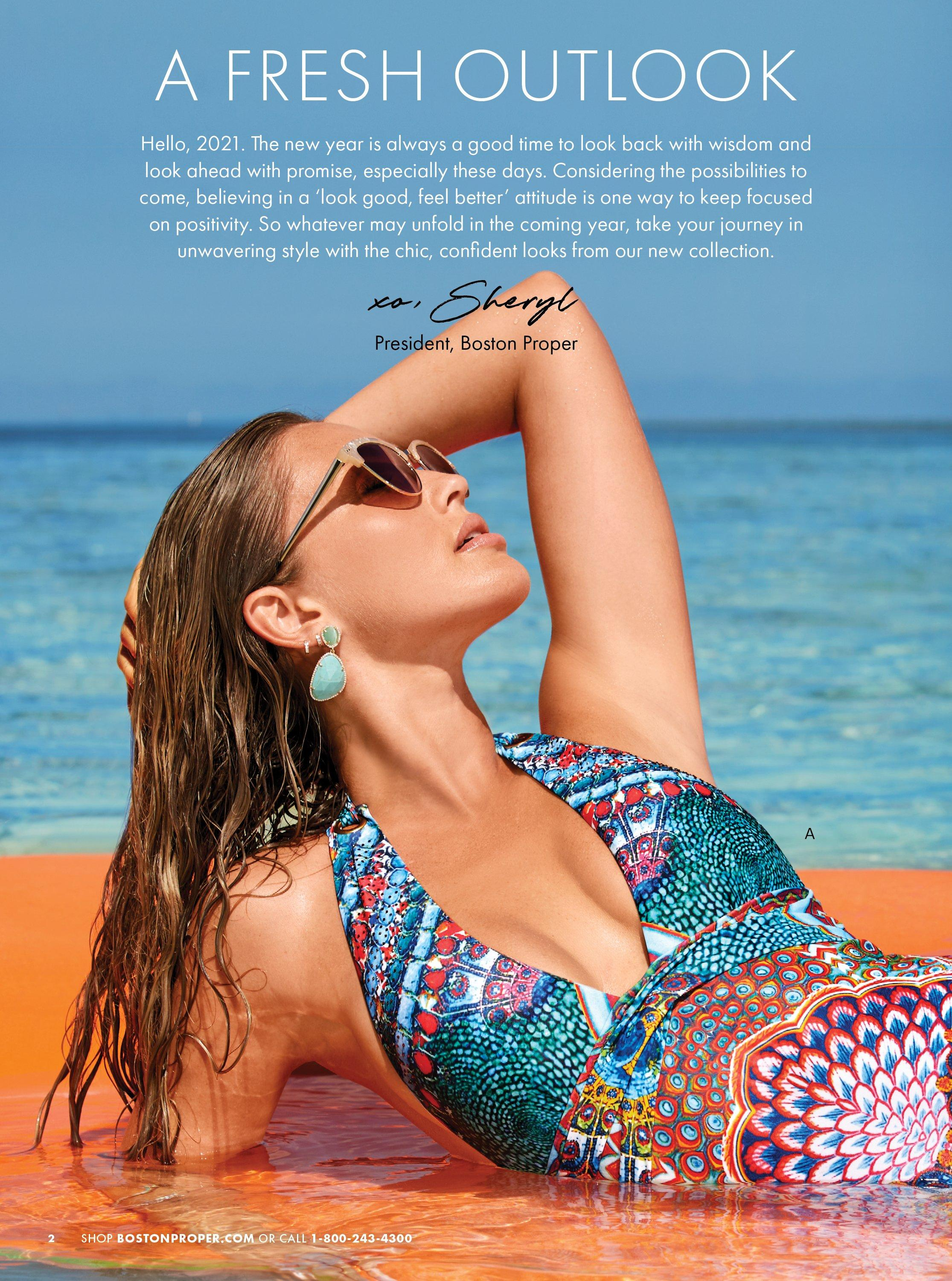 model wearing a printed plunge halter one-piece swimsuit.