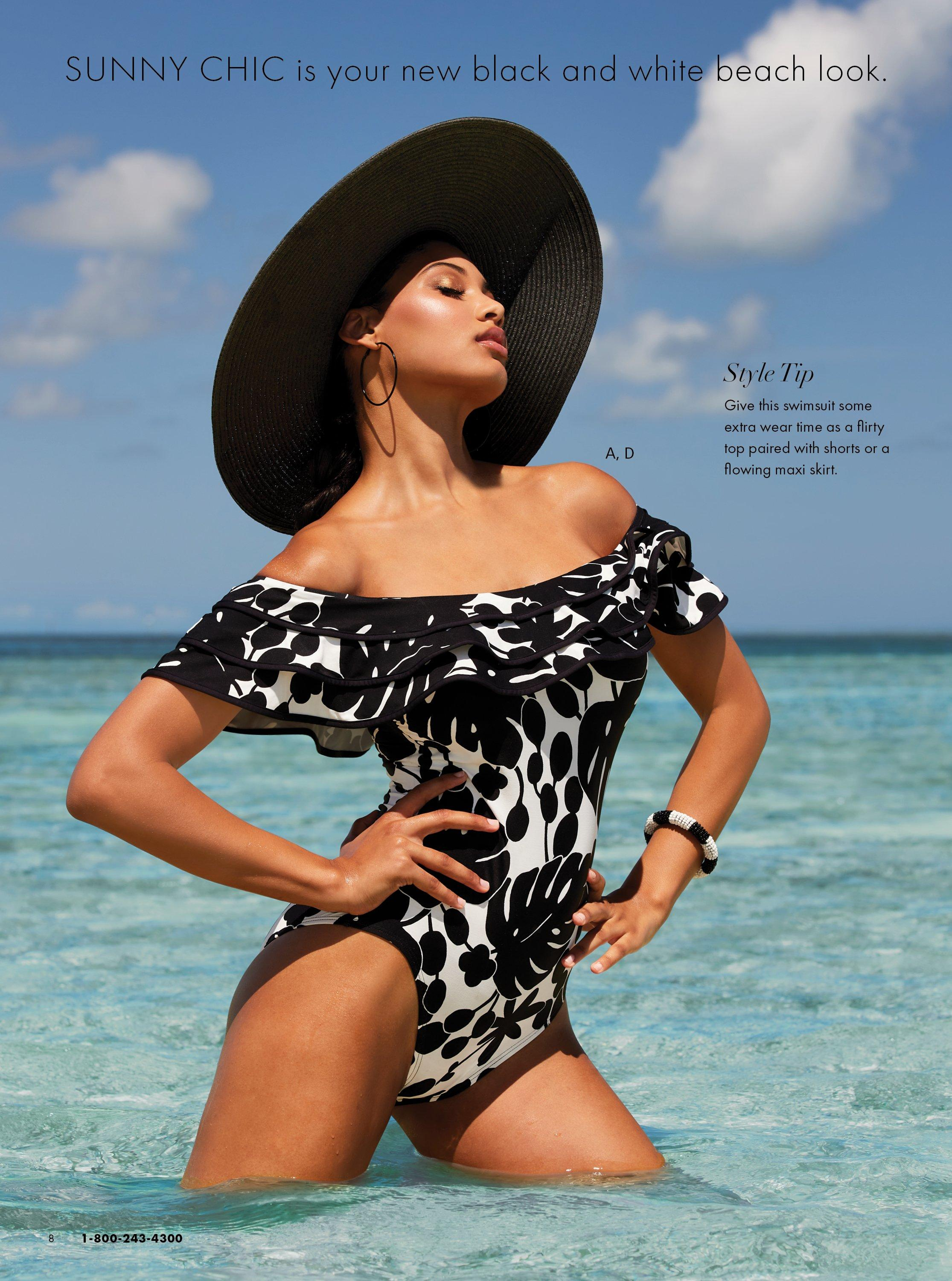 model wearing a black and white ruffle off-the-shoulder one piece swimsuit and a black floppy hat.