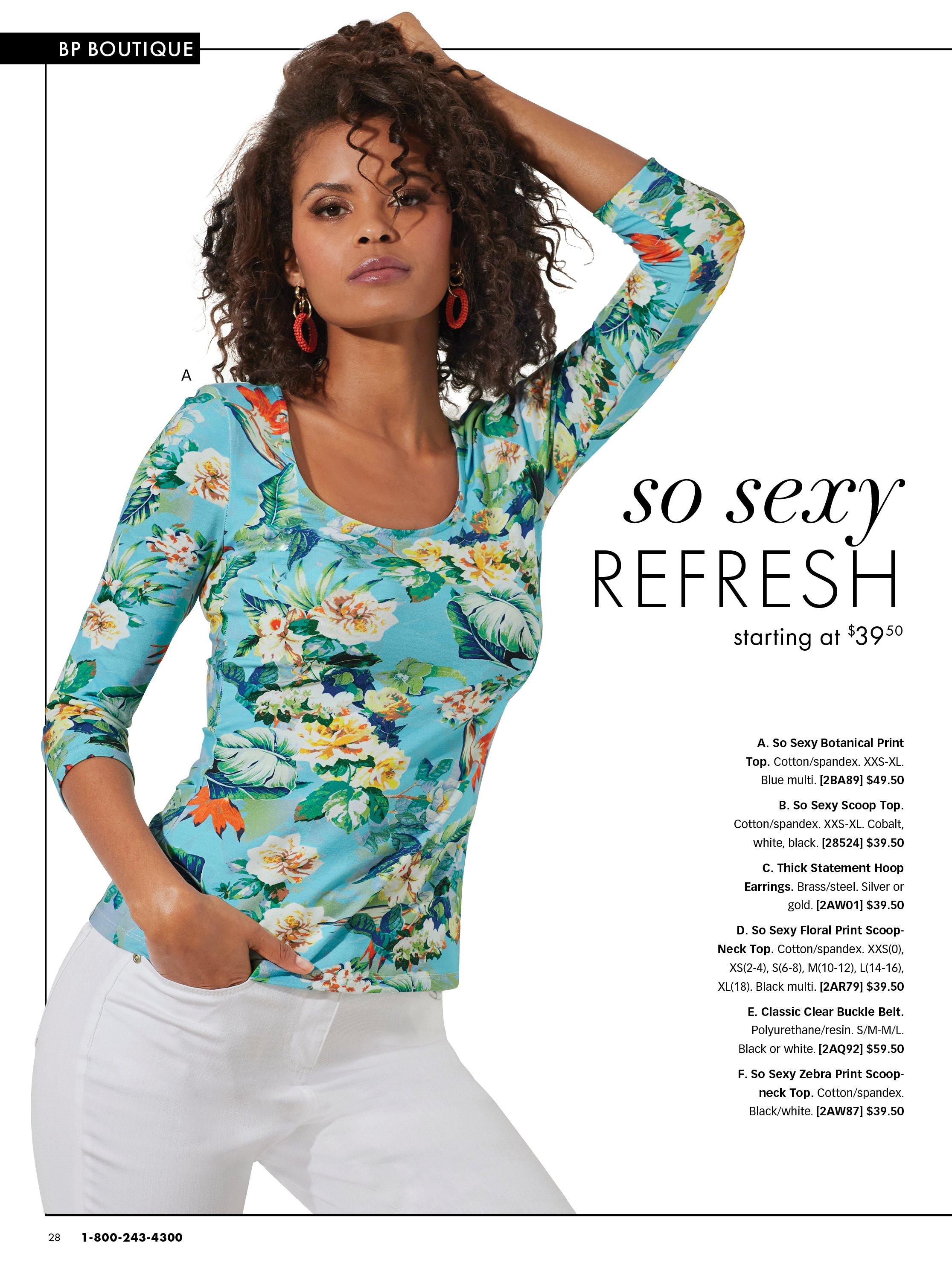 model wearing a blue floral printed long-sleeve scoop neck top and white pants.