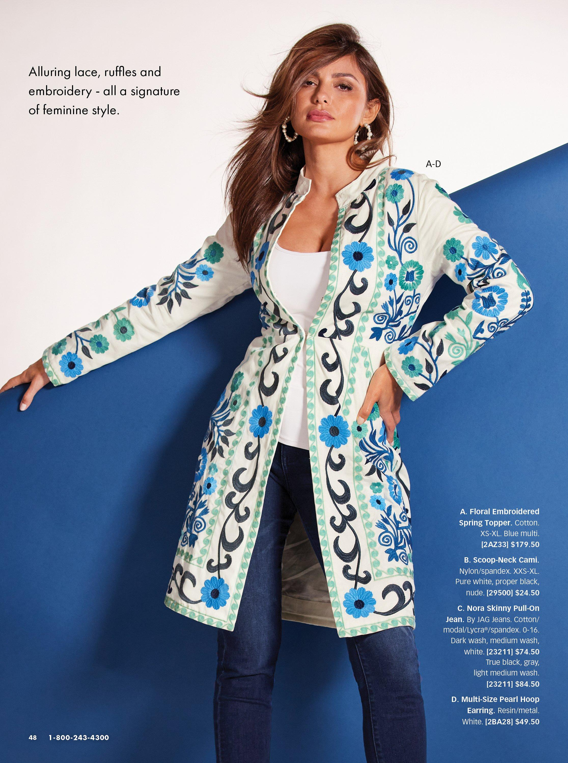 model wearing a white and blue floral embroidered topper jacket, white tank top, jeans, and pearl embellished hoop earrings.