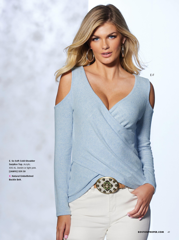 model wearing a light blue cold-shoulder surplice long-sleeve top, jewel embellished belt, and white jeans.