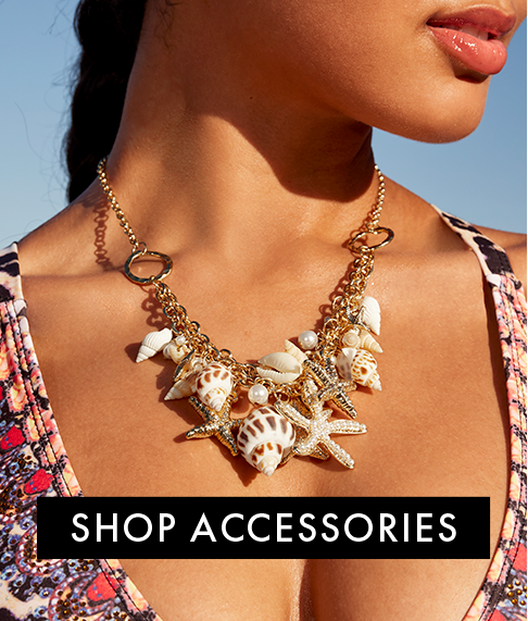 model wearing a sea life gold necklace.