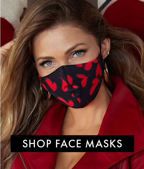 model wearing a red and black face mask.