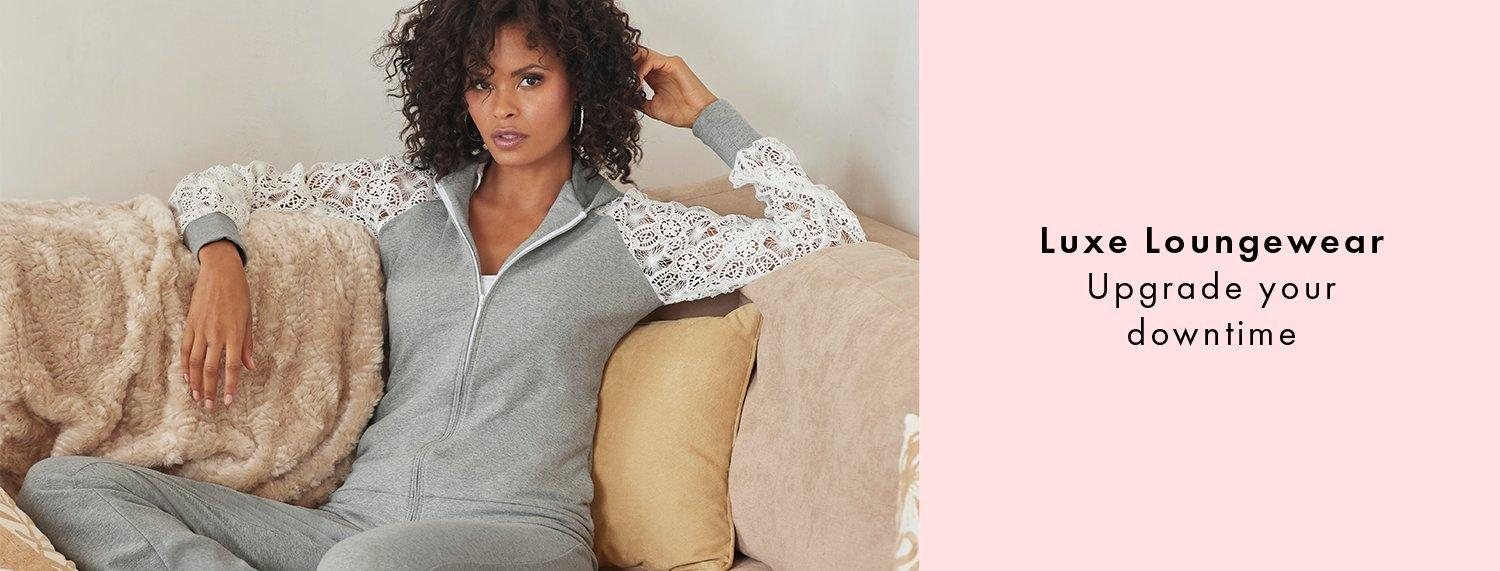 text: luxe loungewear. upgrade your downtime. model wearing a gray and lace sleeve two-piece lounge set.