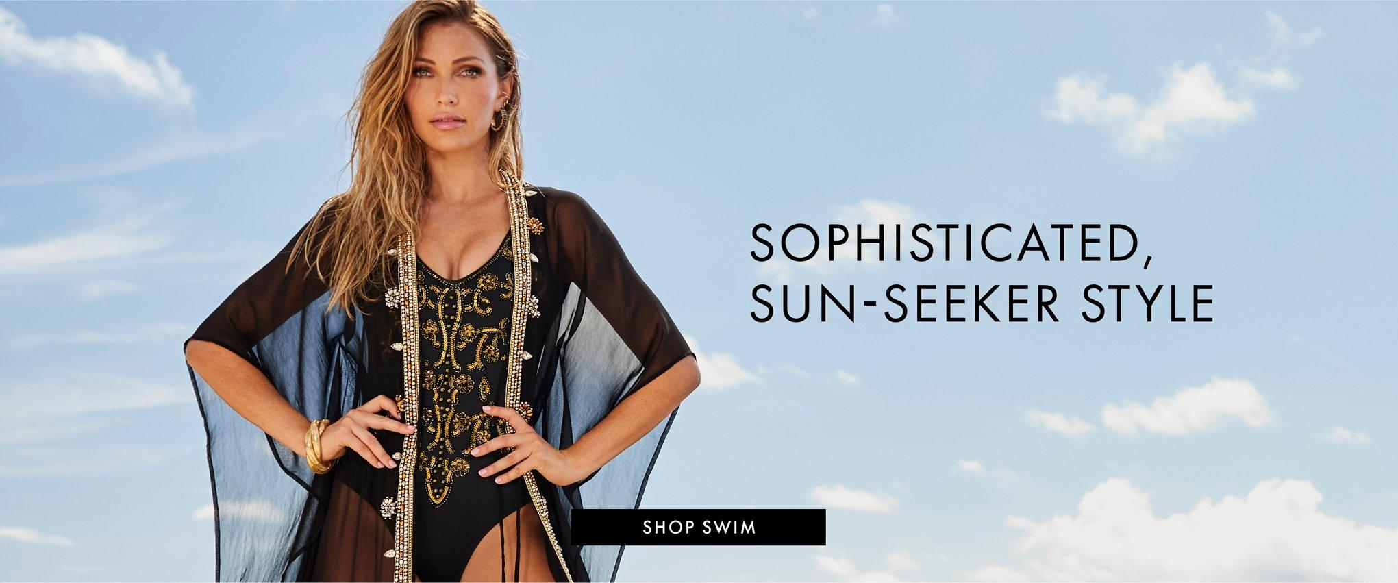 model wearing a black and gold embroidered one-piece swimsuit and black sheer gold jeweled duster cover up.