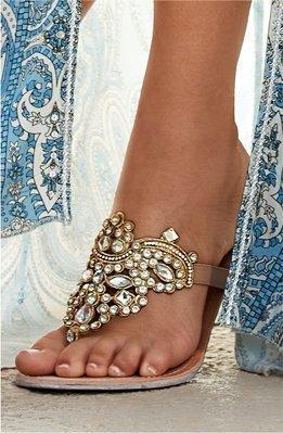 model wearing a beige jewel embellished belt.