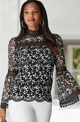 model wearing a multicolor sequin cold-shoulder long-sleeve top and black pants.