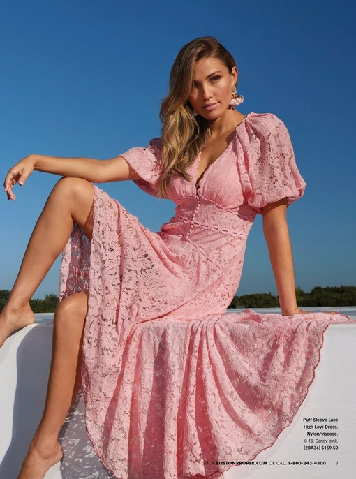 model wearing a pink puff-sleeve lace high-low maxi dress.