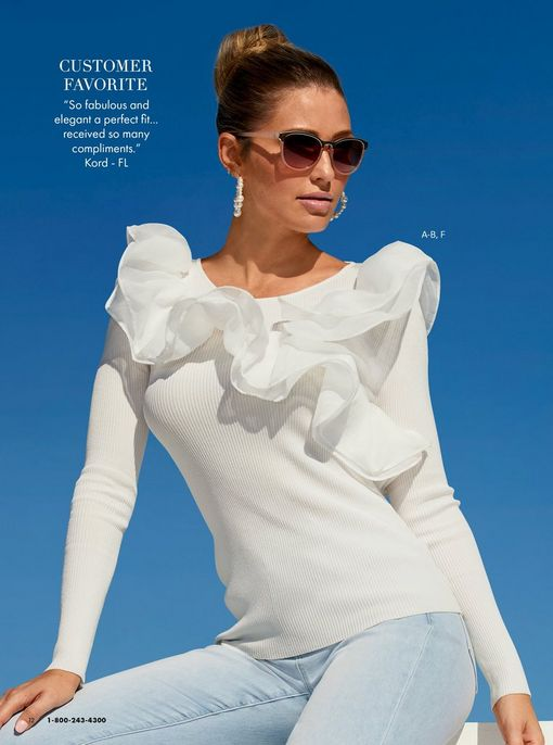model wearing a white ruffle detail long-sleeve top, light wash jeans, sunglasses, and pearl hoop earrings.