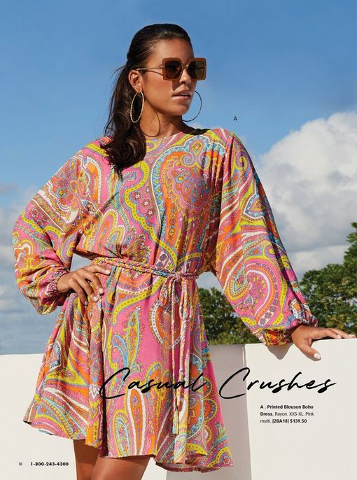 model wearing a multicolored paisley print dress with a tie-waist and sunglasses.
