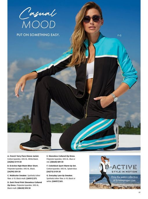 model wearing a blue and black color block two-piece sport set, white sports bra, black sneakers, and sunglasses.