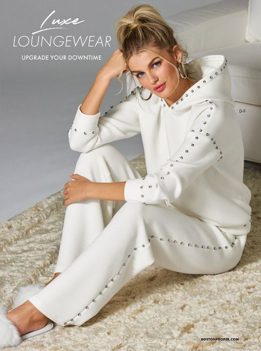 model wearing a white hooded two-piece studded lounge set and white faux fur slippers.