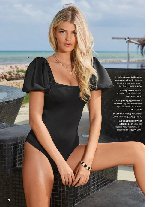 model wearing a puff-sleeve black one-piece swimsuit.