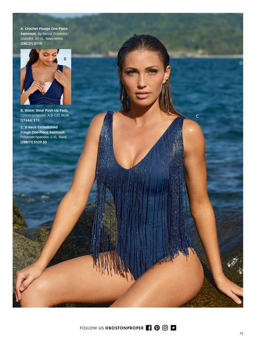 model wearing a navy embellished fringe one-piece swimsuit. also shown: water push-up pads.