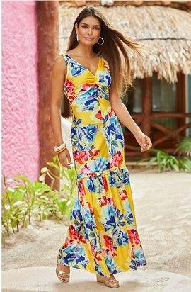 model wearing a multicolored floral sleeveless maxi dress.