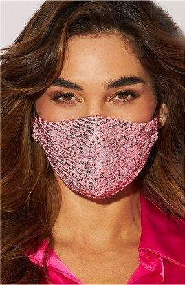model wearing a light pink sequin face mask.