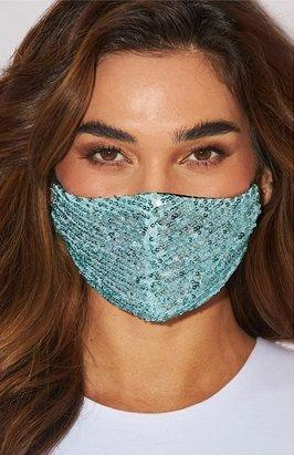model wearing a blue sequin face mask.
